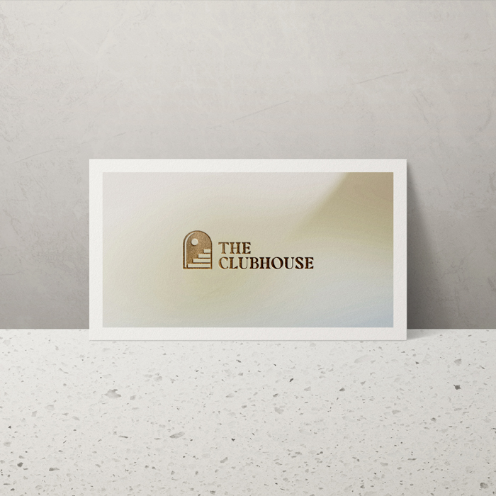 The Clubhouse Business Card on a marbletop table