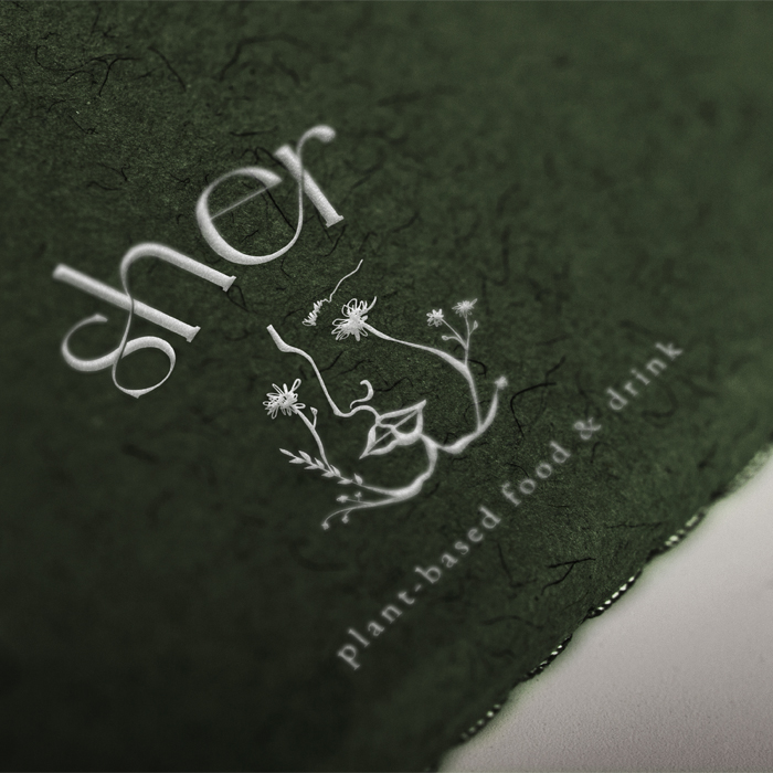 Close up of Sher logo