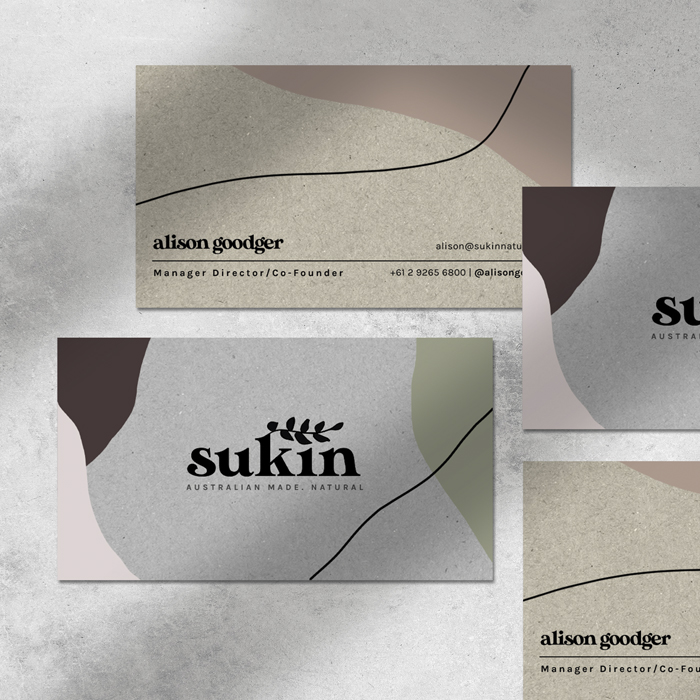 Four business cards for the brand Sukin Skincare